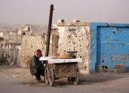 A street vendor waits for customers in Douma