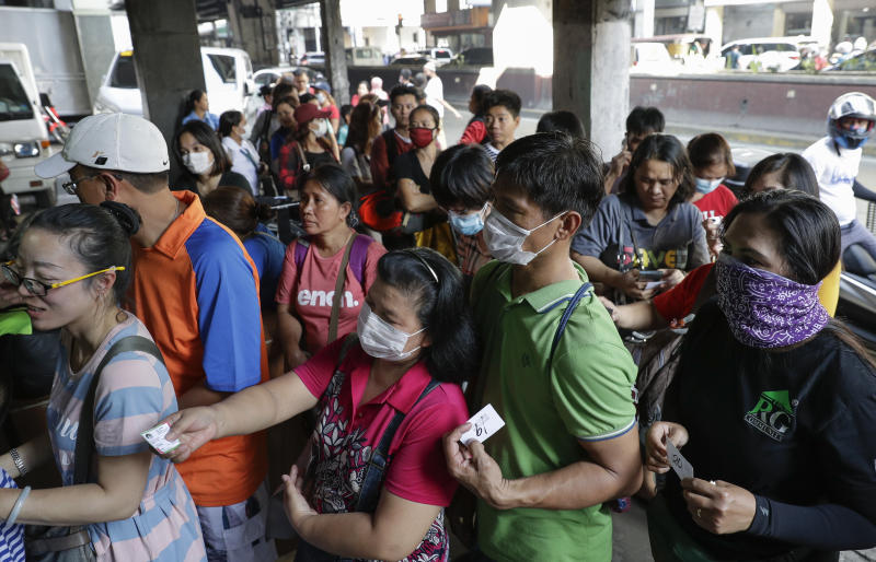 File Photo: People queue up to buy protective face masks at a store in Manila, Philippines, Thursday, Jan. 30, 2020. (AP Photo/Aaron Favila)