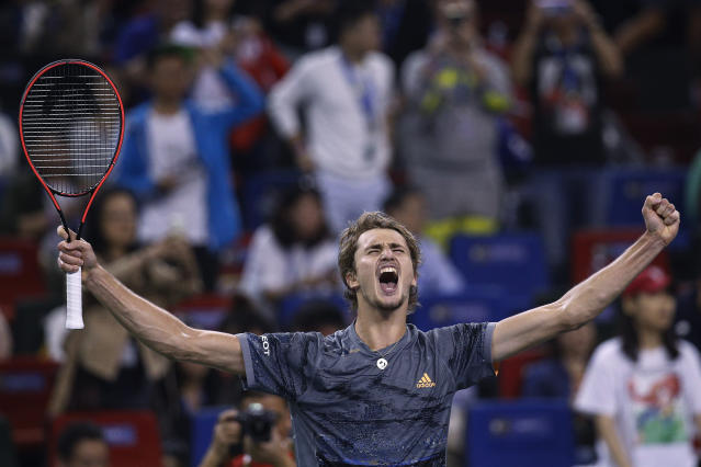 Alexander Zverev of Germany celebrates after defeating Roger Federer of Switzerland in their men's singles quarterfinals match at the Shanghai Masters tennis tournament at Qizhong Forest Sports City Tennis Center in Shanghai, China, Friday, Oct. 11, 2019. (AP Photo/Andy Wong)
