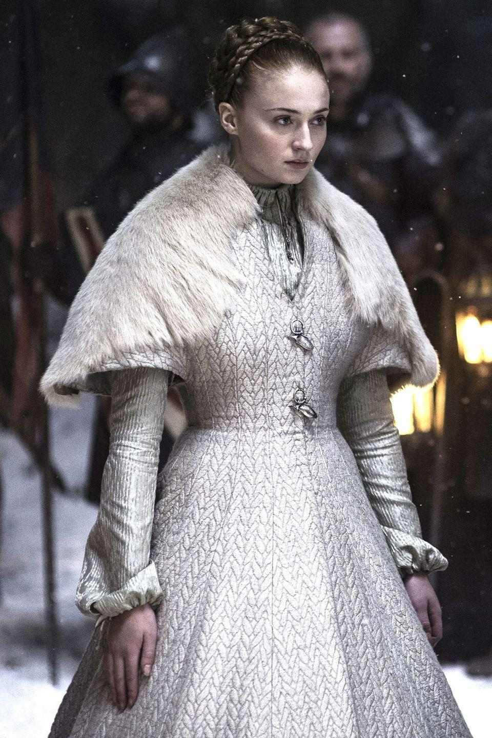 <p>Sansa's wedding ended horribly, but before viewers were left permanently scarred at the end of the season 5 episode, she walked down a snowy aisle in this winter wedding dress. It featured a fur shawl on top of a thick, quilted dress and long sleeves. </p>