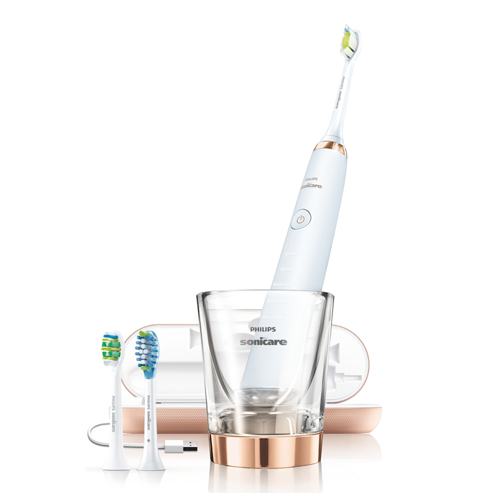 """""""This is the gold standard I always recommend,"""" says New York City-based cosmetic dentist <a href=""""https://veytsmandds.com/"""" rel=""""nofollow noopener"""" target=""""_blank"""" data-ylk=""""slk:Victoria Veytsman"""" class=""""link rapid-noclick-resp"""">Victoria Veytsman</a>, who has worked with celebs like <a href=""""https://www.allure.com/story/hailey-baldwin-rose-gold-hair-color?mbid=synd_yahoo_rss"""" rel=""""nofollow noopener"""" target=""""_blank"""" data-ylk=""""slk:Hailey Baldwin"""" class=""""link rapid-noclick-resp"""">Hailey Baldwin</a>. The brush features five different cleaning modes, which send specific vibrations and cleaning durations to the brush head. (In other words, you get a different type of clean depending on whether you want to lift away coffee stains or polish off plaque). """"My patients always report feeling super clean, and I notice improved tissue health and less plaque,"""" says Veytsman. Not to mention, this brush comes with some top-notch accessories: The cup-shaped charger activates as soon as you drop your brush in, and the travel case makes it super-easy to keep the bits and pieces together when you're on the go."""