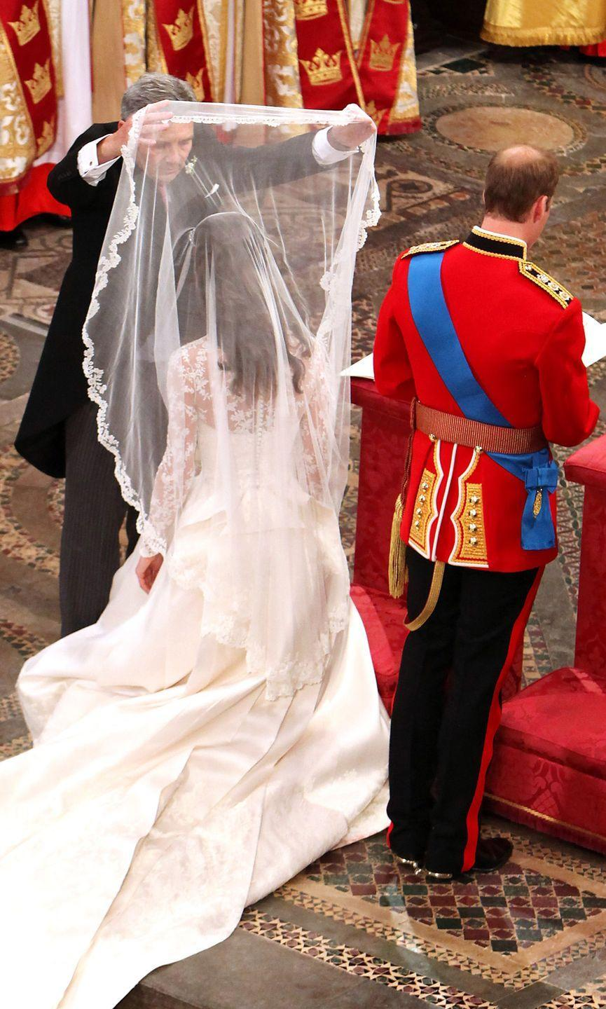 "<p>Kate took her place beside William after her father Michael lifted her veil. 'You look beautiful,' the groom told his bride.</p><p>Watch the moment Kate walked down the aisle <a href=""https://www.youtube.com/watch?v=5u6-CpU-1EY"" rel=""nofollow noopener"" target=""_blank"" data-ylk=""slk:here"" class=""link rapid-noclick-resp"">here</a>.</p>"