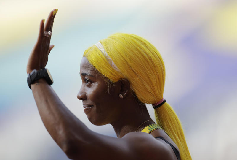 Shelly-Ann Fraser-Pryce, of Jamaica, waves after finishing at the women's 100 meter heat at the World Athletics Championships in Doha, Qatar, Saturday, Sept. 28, 2019. (AP Photo/Petr David Josek)