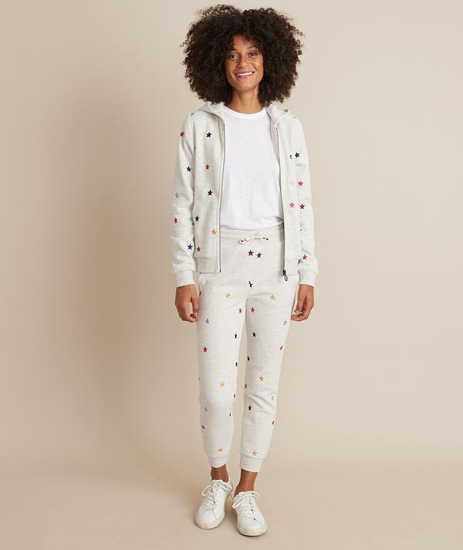 """<p>In addition to the cute and colorful embroidered star detail on the Marine Layer Signature Lined Jogger and Hoodie, the all-around more tailored fit and pockets take the edge off of how casual a class sweatsuit can look. Both pieces are made even cozier thanks to a fleece lining. </p> <p><strong>Sizes available:</strong> XS to XL</p> <p><strong>$98 for the jogger</strong> (<a href=""""https://www.marinelayer.com/collections/gals-loungewear/products/signature-lined-jogger-ash-heather-w-stars?variant=32504605605962"""" rel=""""nofollow noopener"""" target=""""_blank"""" data-ylk=""""slk:Shop Now"""" class=""""link rapid-noclick-resp"""">Shop Now</a>) and <strong>$125 for the hoodie</strong> (<a href=""""https://www.marinelayer.com/collections/gals-loungewear/products/signature-lined-hoodie-ash-heather-w-stars?variant=32504545706058"""" rel=""""nofollow noopener"""" target=""""_blank"""" data-ylk=""""slk:Shop Now"""" class=""""link rapid-noclick-resp"""">Shop Now</a>)</p>"""