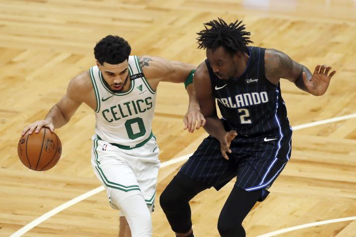Boston Celtics' Jayson Tatum (0) drives past Orlando Magic's Al-Farouq Aminu (2) during the first half on an NBA basketball game, Sunday, March 21, 2021, in Boston. (AP Photo/Michael Dwyer)