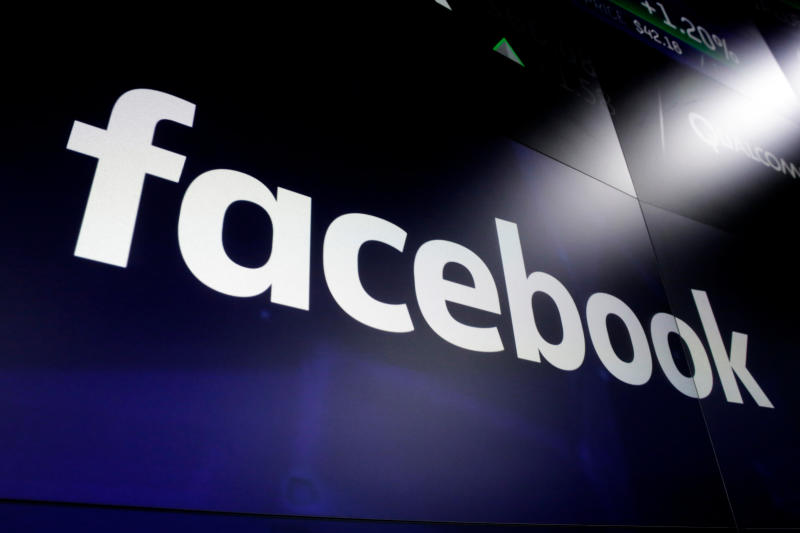 FILE - In this March 29, 2018 file photo shows the logo for Facebook at the Nasdaq MarketSite, in New York's Times Square.  Facebook on Friday, Feb. 14, 2020,  decided to allow a type of paid political message that sidesteps many of the social network's rules governing political ads.  Its policy change comes days after presidential candidate Michael Bloomberg exploited a loophole to run such humorous messages promoting his campaign on the accounts of popular Instagram personalities followed by millions of young voters.(AP Photo/Richard Drew, File)