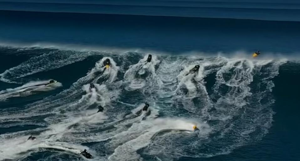 A huge group of jet skis scrambled to pass over the wave in time to land safely. Source: Surfline