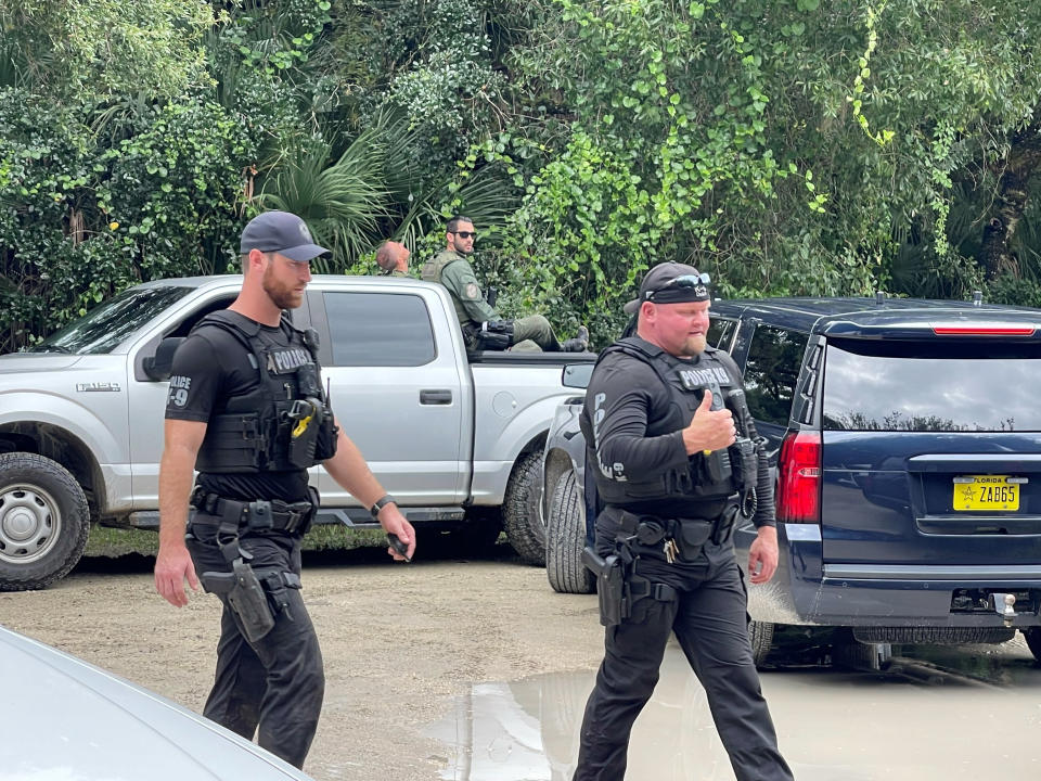 """This photo provided by North Port Police Department, law enforcement officials conduct a search of the vast Carlton Reserve in the Sarasota, Fla., area for Brian Laundrie on Saturday, Sept. 18, 2021. Laundrie is a person of interest in the disappearance of his girlfriend, Gabrielle """"Gabby"""" Petito. (North Port Police Department via AP)"""