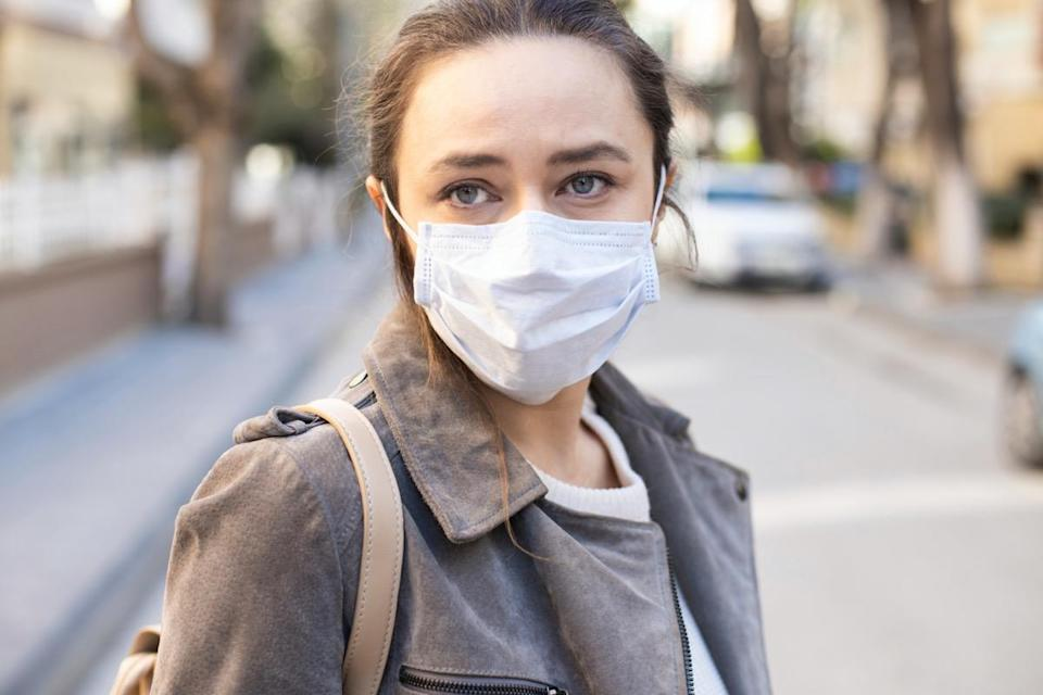 woman with face mask on the street