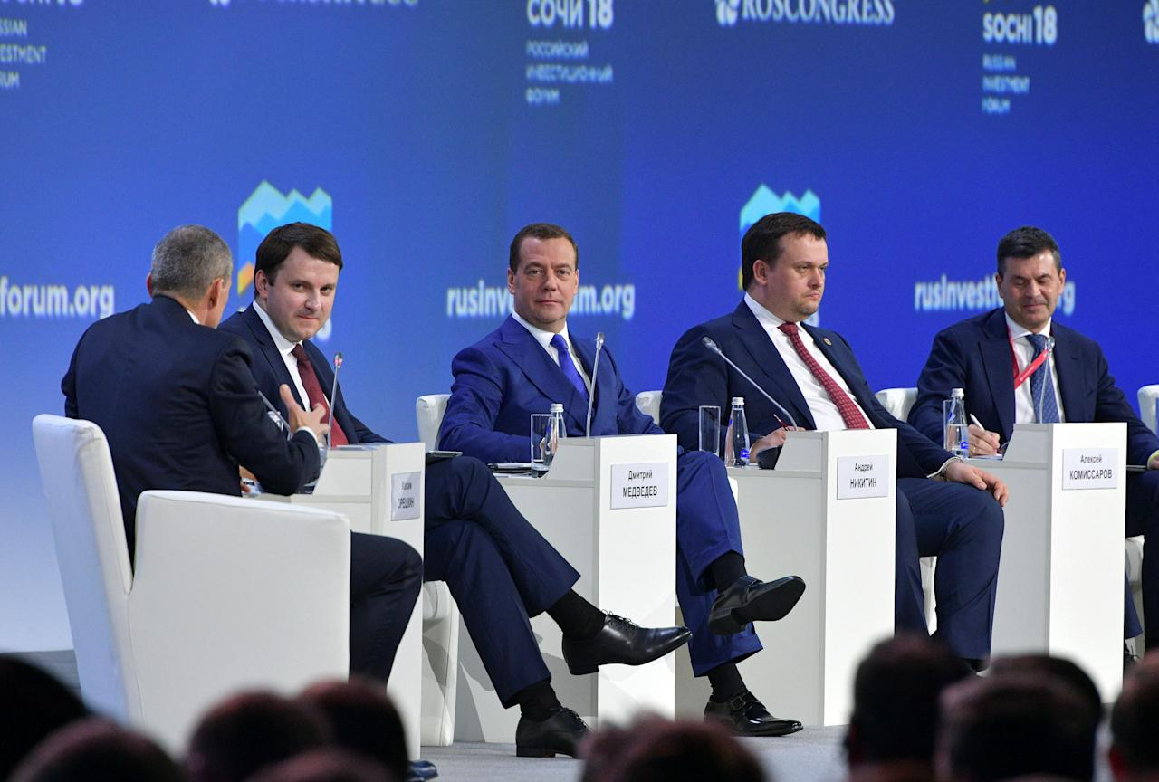 Russian Prime Minister Dmitry Medvedev and Economy Minister Maxim Oreshkin attend a session of the Russian Investment Forum in the Black Sea resort of Sochi, Russia February 15, 2018. Sputnik/Dmitry Astakhov/Pool via REUTERS ATTENTION EDITORS - THIS IMAGE WAS PROVIDED BY A THIRD PARTY.