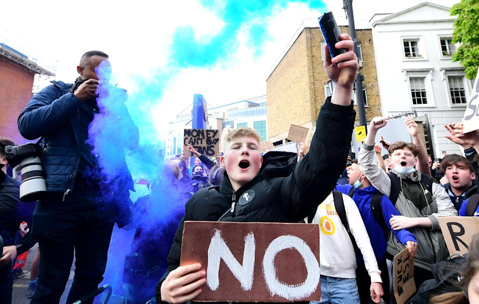 Chelsea fans outside Stamford Bridge protest against the club's involvement in the proposed European Super League (PA Wire)