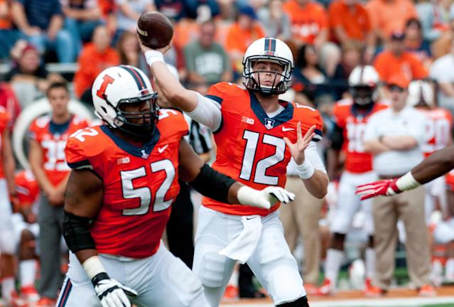 Illinois quarterback Wes Lunt (12) throws a pass during the first quarter of an NCAA college football game against the Western Kentucky, Saturday, Sept. 6, 2014, at Memorial Stadium in Champaign, Ill. (AP Photo/Bradley Leeb)