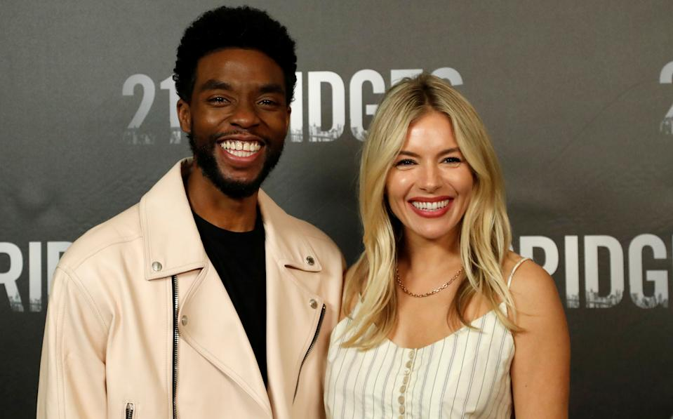 Sienna Miller honors her 21 Bridges co-star Chadwick Boseman after his untimely passing.
