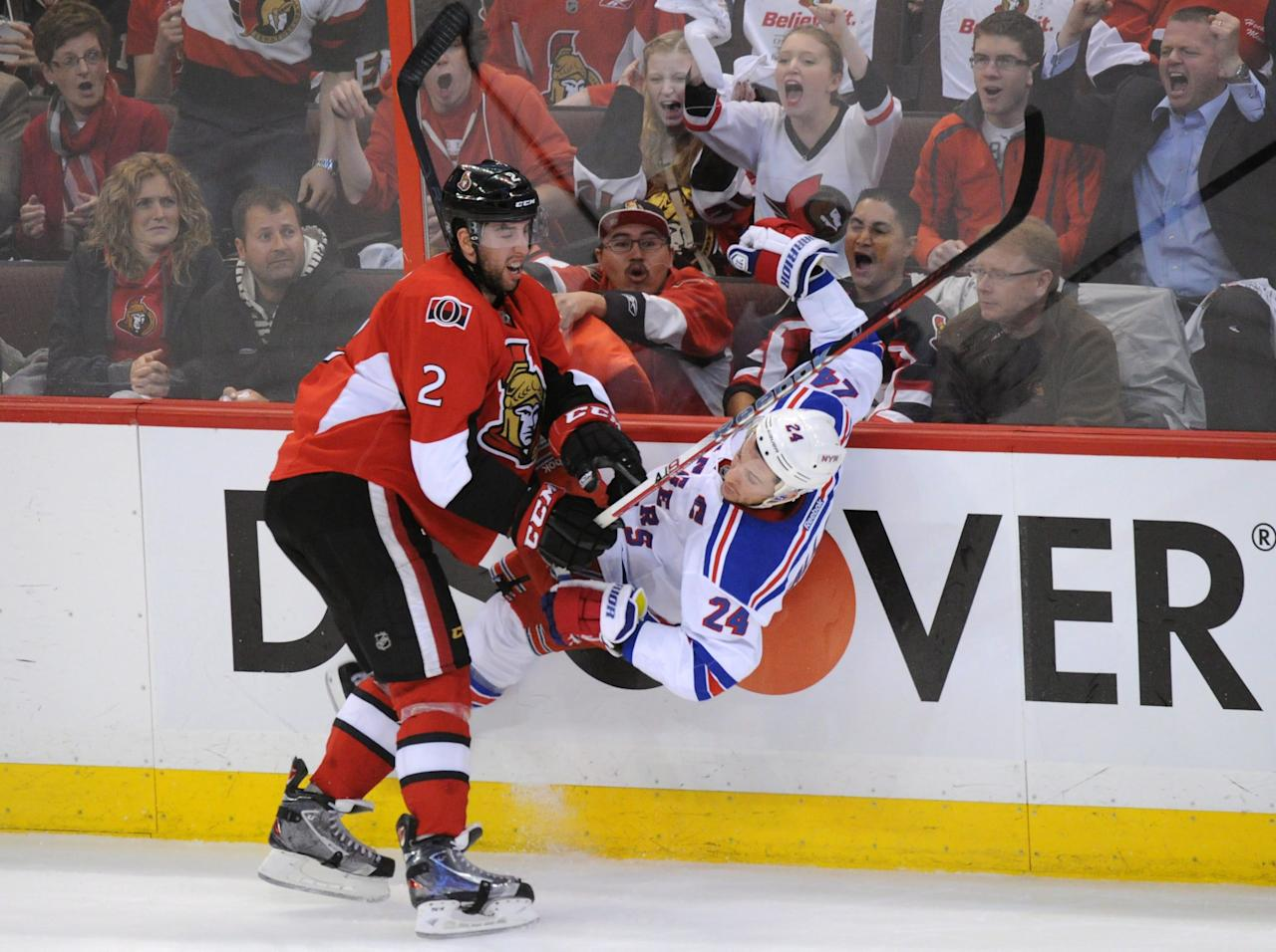 Ottawa Senators' Jared Cowen hits New York Rangers' Ryan Callahan during the first period of Game 6 of a first-round NHL Stanley Cup playoff hockey series, in Ottawa, Ontario, on Monday, April 23, 2012. (AP Photo/The Canadian Press, Sean Kilpatrick)