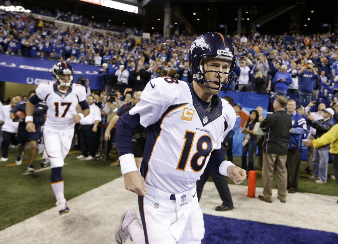 Denver Broncos quarterback Peyton Manning (18) runs out on the field before an NFL football game against the Indianapolis Colts, Sunday, Oct. 20, 2013, in Indianapolis. (AP Photo/Michael Conroy)