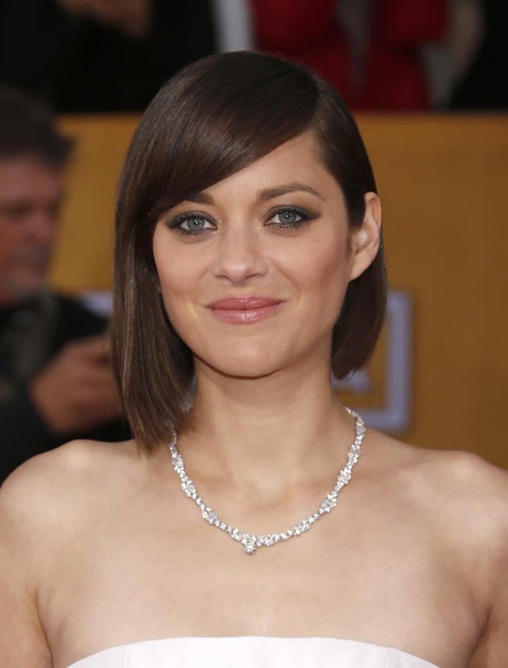 Marion Cotillard arrives at the 19th Annual Screen Actors Guild Awards at the Shrine Auditorium in Los Angeles on Sunday Jan. 27, 2013. (Photo by Todd Williamson/Invision for The Hollywood Reporter/AP Images)