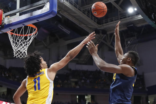 Oscar Tshiebwe, right, shoots over Justin Champagnie (11) during the first half of an NCAA college basketball game, Friday, Nov. 15, 2019, in Pittsburgh. (AP Photo/Keith Srakocic)
