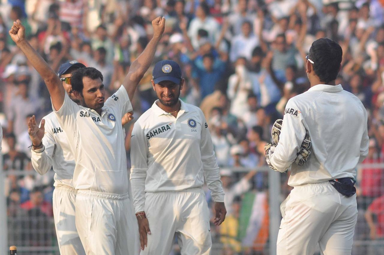 Indian cricket team celebrates after winning 1st test match between India and West Indies at Eden Gardens by an innings in Kolkata on Nov.8, 2013. (Photo: IANS)