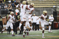 Boston College's Hamp Cheevers (4) and Brandon Sebastian (10) celebrate Cheevers' interception during the first half of an NCAA college football game against Wake Forest, Thursday, Sept. 13, 2018, in Winston-Salem, N.C. (AP Photo/Woody Marshall)