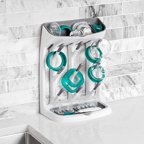 """<p><strong>OXO</strong></p><p>amazon.com</p><p><strong>$24.99</strong></p><p><a href=""""https://www.amazon.com/dp/B079K783F9?tag=syn-yahoo-20&ascsubtag=%5Bartid%7C10069.g.35851585%5Bsrc%7Cyahoo-us"""" rel=""""nofollow noopener"""" target=""""_blank"""" data-ylk=""""slk:Shop Now"""" class=""""link rapid-noclick-resp"""">Shop Now</a></p><p>New moms may not realize how useful this is until they see how quickly baby bottles take over the kitchen. This ergonomic rack keeps everything organized in a slim profile and will easily become one of the most used items in the house.</p>"""