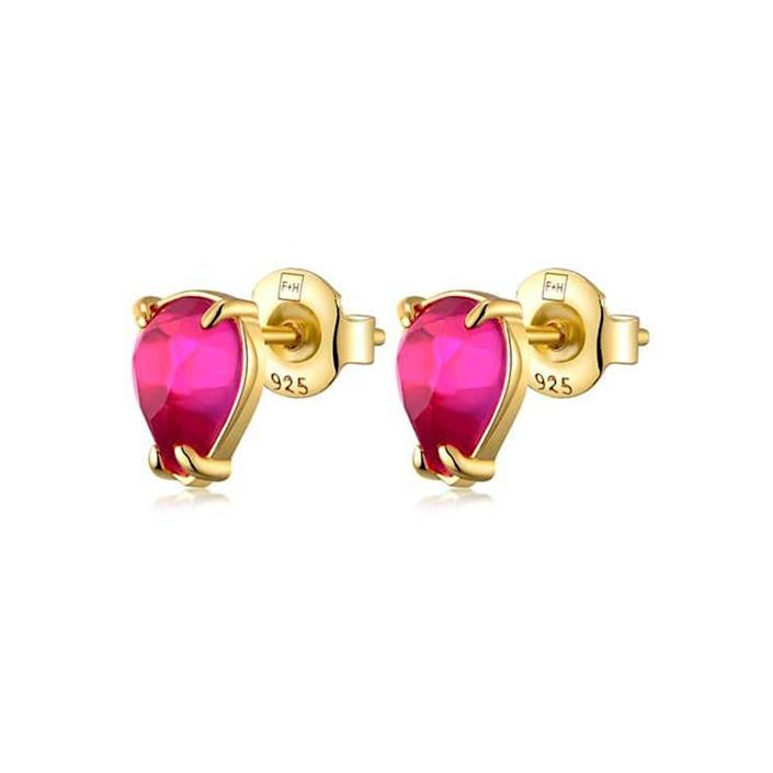 """<p><strong>F+H</strong></p><p>fandhjewellery.com</p><p><strong>$130.00</strong></p><p><a href=""""https://www.fandhjewellery.com/collections/pop/products/teardrops-pink-corundum"""" rel=""""nofollow noopener"""" target=""""_blank"""" data-ylk=""""slk:Shop Now"""" class=""""link rapid-noclick-resp"""">Shop Now</a></p><p>These studs will add a vivid pop of color to any outfit. </p>"""