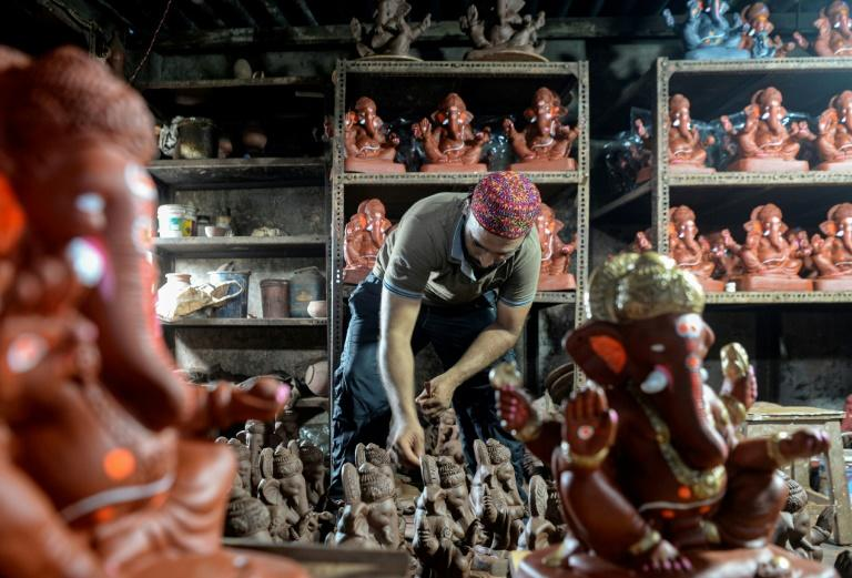 Indian Muslim artisan fights virus slowdown with Hindu idols