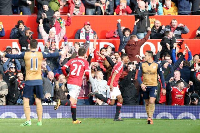 Manchester United's Marcus Rashford (centre) celebrates scoring on his Premier League debut against Arsenal