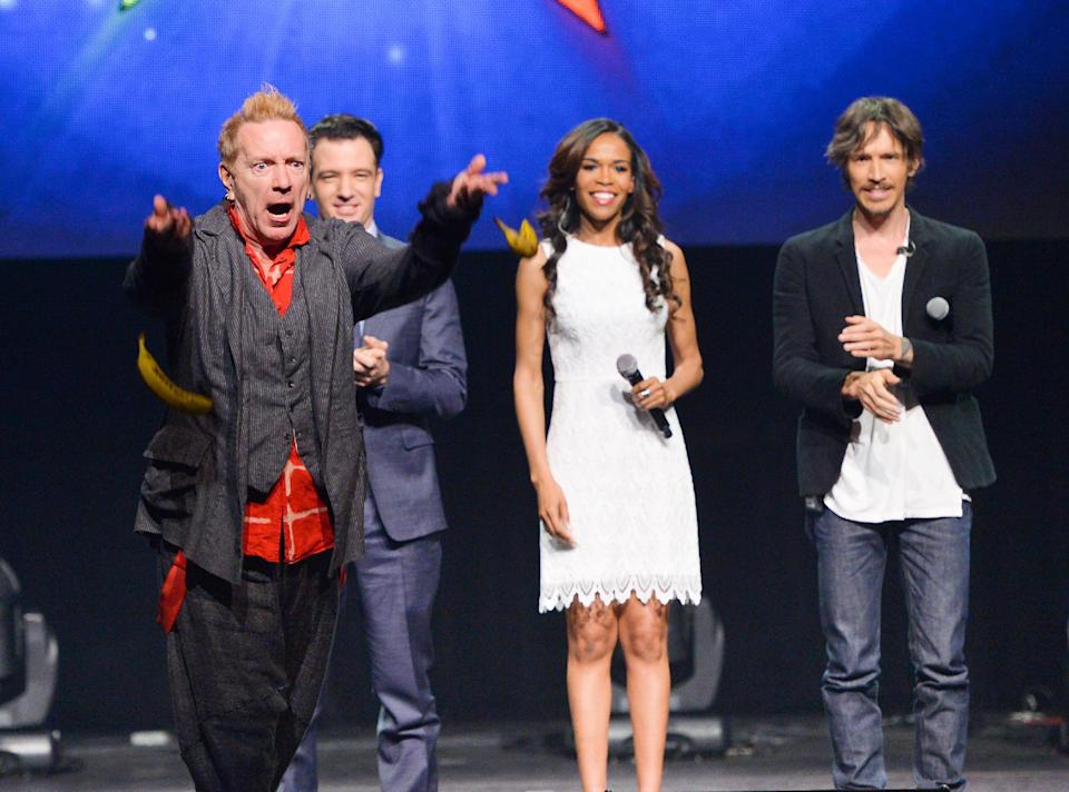 """From left, singer John Rotten Lydon throws bananas at the media, JC Chasez, Michelle Williams and Brandon Boyd look on, at the """"Jesus Christ Superstar"""" arena spectacular press conference and press performance to announce a North American arena tour on Friday, April 4, 2014, in New York. (Photo by Evan Agostini/Invision/AP)"""
