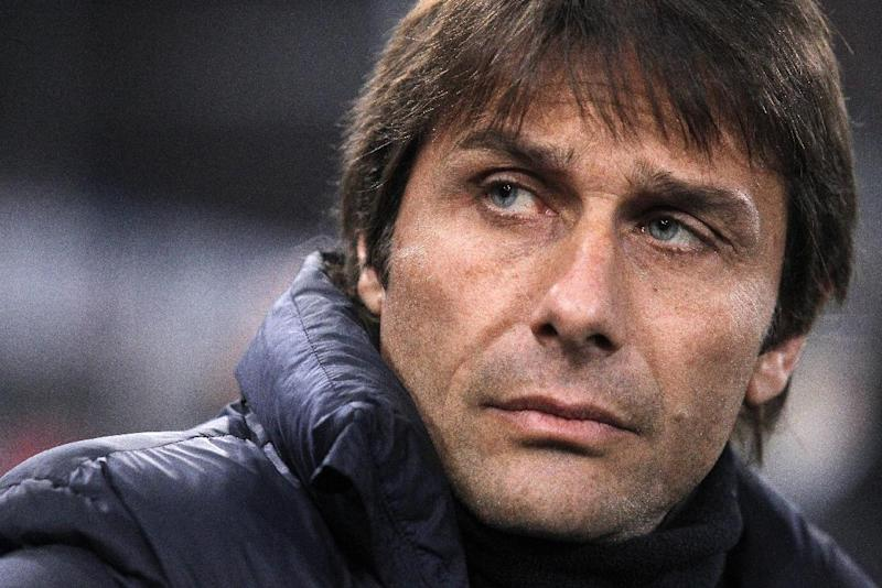 A file photo taken on March 16, 2014 shows former Juventus coach Antonio Conte looking on during the Italian Serie A football match Genoa vs Juventus in Luigi Ferraris Stadium in Genoa