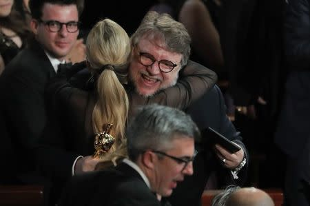 90th Academy Awards - Oscars Show – Hollywood - Director Guillermo del Toro is hugged by his guest Kim Morgan after winning Best Director for The Shape of Water. REUTERS/Lucas Jackson