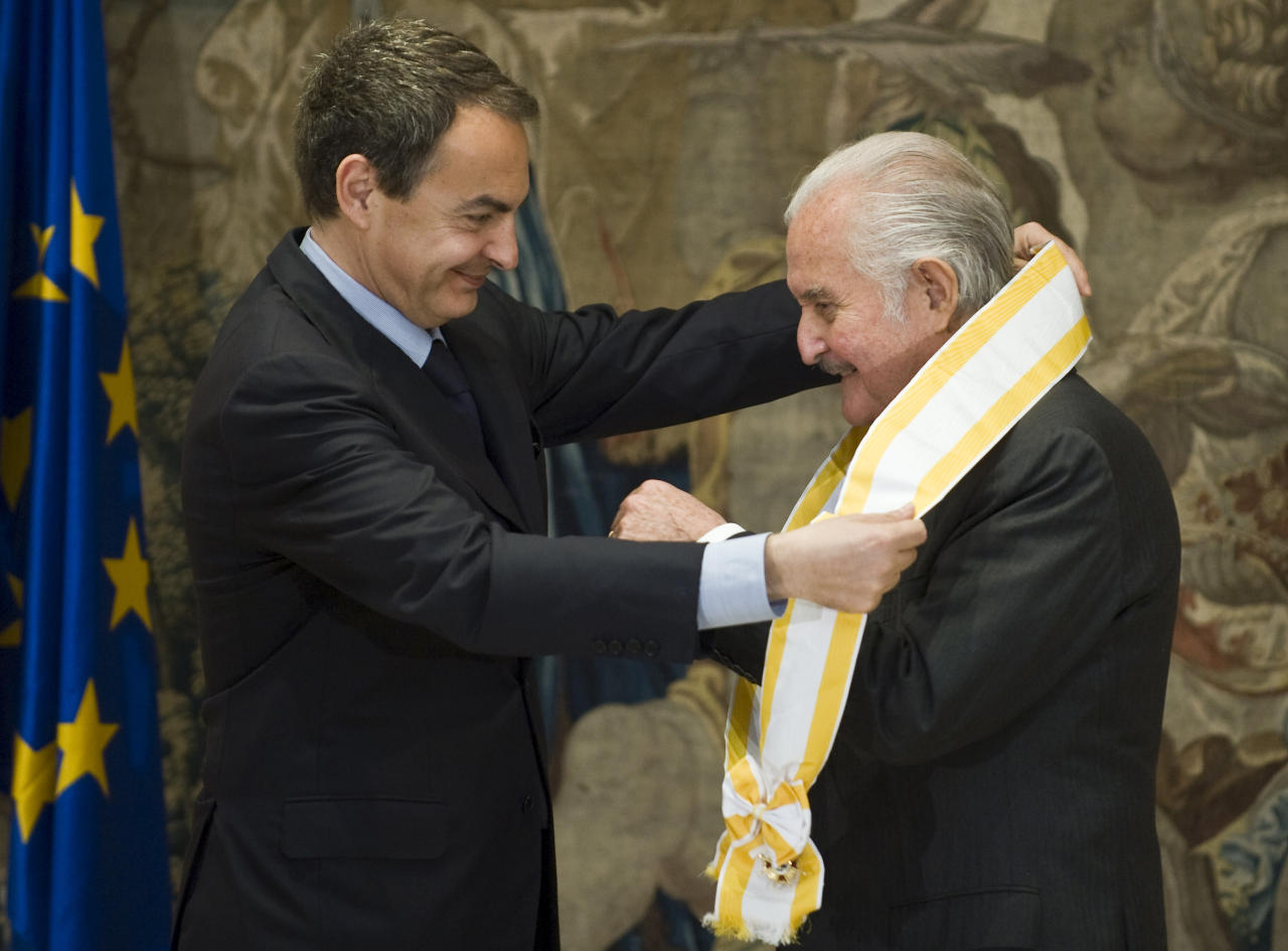 FILE - In this March 24, 2009 file photo, Spain's Prime Minister Jose Luis Rodriguez Zapatero honors Mexican writer Carlos Fuentes during the Gran Cruz Isabel La Catolica medal ceremony, one of the most important distinctions given by the Spanish government to foreign personalities, at the Moncloa Palace in Madrid, Spain. Fuentes, Mexico's most celebrated novelist and among Latin America's most prominent authors, died on May 15, 2012. (AP Photo/Daniel Ochoa de Olza, File)