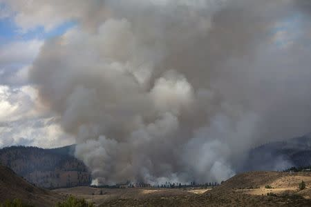 Smoke rises from the Carlton Complex Fire near Winthrop