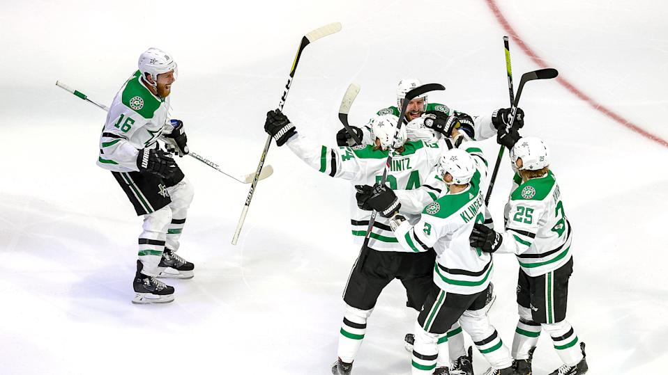 EDMONTON, ALBERTA - SEPTEMBER 14:  Denis Gurianov #34 of the Dallas Stars is congratulated by his teammates after scoring the game-winning goal against the Vegas Golden Knights during the first overtime period to win Game Five of the Western Conference Final during the 2020 NHL Stanley Cup Playoffs at Rogers Place on September 14, 2020 in Edmonton, Alberta, Canada. (Photo by Bruce Bennett/Getty Images)
