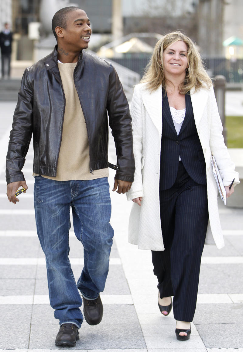 Rapper Ja Rule, left, leaves the Martin Luther King, Jr. Courthouse with his lawyer Stacey Richman after pleading guilty to federal tax evasion charges, Tuesday, March 22, 2011, in Newark, N.J. Ja Rule admitted he failed to pay taxes on more than $3 million earned between 2004 and 2006. (AP Photo/Julio Cortez)