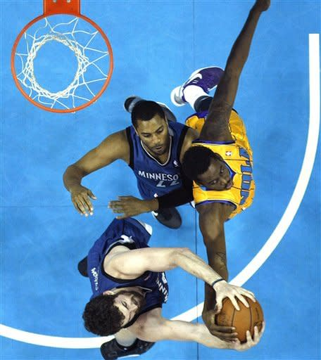 New Orleans Hornets forward Al-Farouq Aminu (0), right, battles for a rebound against Minnesota Timberwolves guard Wayne Ellington (22) and center Nikola Pekovic, bottom, in the first half of an NBA basketball game in New Orleans, Saturday, April 7, 2012. (AP Photo/Gerald Herbert)