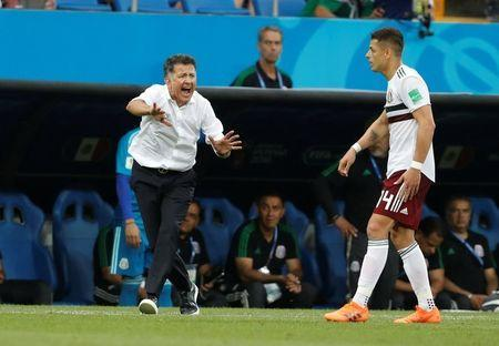 Soccer Football - World Cup - Group F - South Korea vs Mexico - Rostov Arena, Rostov-on-Don, Russia - June 23, 2018 Mexico coach Juan Carlos Osorio reacts as Javier Hernandez looks on REUTERS/Damir Sagolj