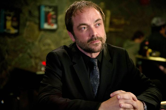 Crowley with his hands clasped