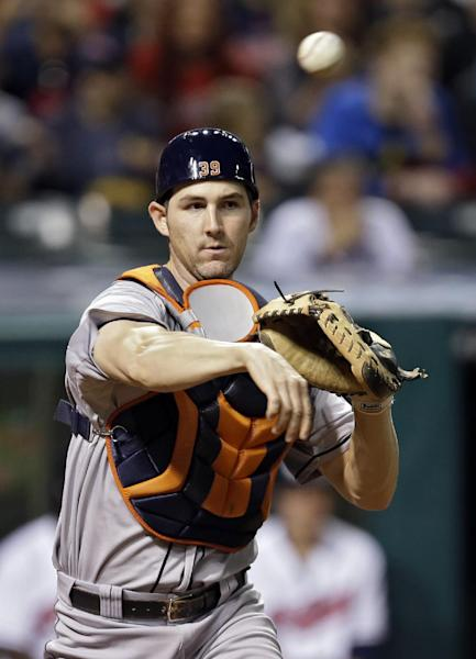 Houston Astros catcher Cody Clark throws to first after a force at home to complete a double play on Cleveland Indians' Lonnie Chisenhall ending the seventh inning of a baseball game Saturday, Sept. 21, 2013, in Cleveland. (AP Photo/Mark Duncan)
