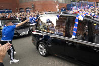 Rangers fans launch scarfs on to the funeral procession of former Rangers player Ricksen outside Ibrox. (Photo by Jane Barlow/PA Images via Getty Images)