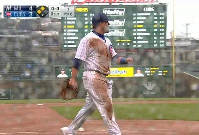 Kyle Schwarber sports a messy uniform as his double-error on Friday at Wrigley Field. (MLB)