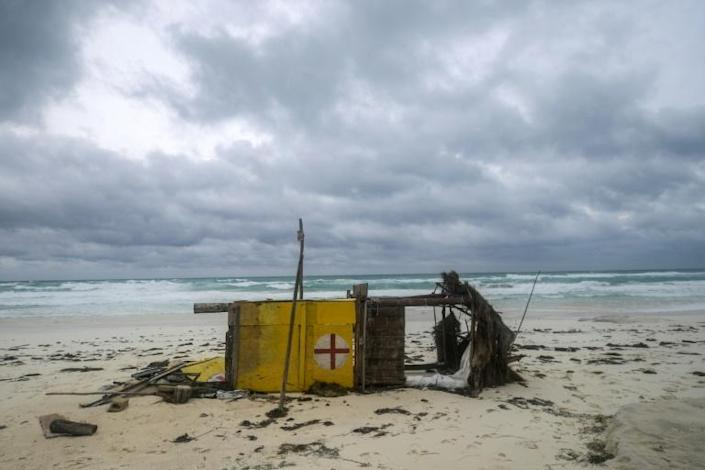 A lifeguard hut blown over by Hurricane Delta lies on its side on a beach in the Mexican resort of Cancun