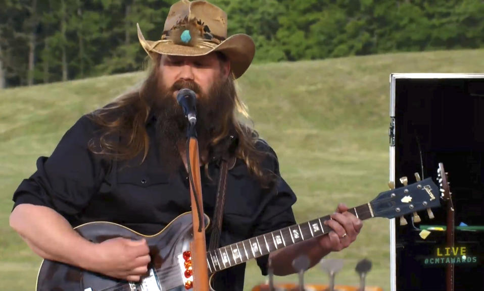 """In this video image provided by CMT, Chris Stapleton performs """"Arkansas"""" at the CMT Music Awards, airing on Wednesday, June 9, 2021. (CMT via AP)"""