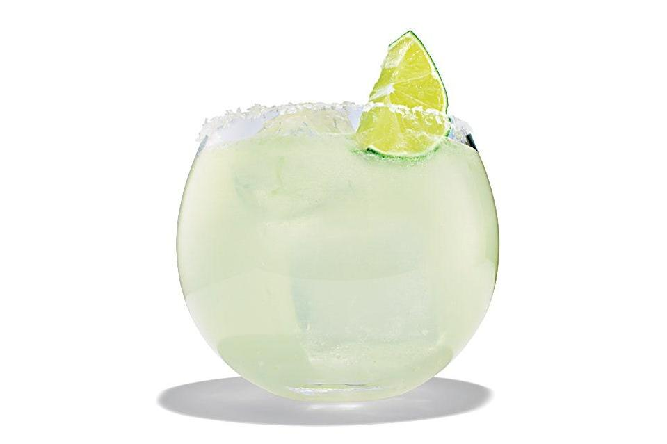"This bright, simple version of the drink leaves out triple sec and uses simple syrup instead for a straightforward lime-and-tequila flavor. Be sure to use good tequila for this refreshing cocktail, so that the herbal, grassy flavors of the spirit come through. <a href=""https://www.epicurious.com/recipes/food/views/margarita-tequila-cocktail?mbid=synd_yahoo_rss"" rel=""nofollow noopener"" target=""_blank"" data-ylk=""slk:See recipe."" class=""link rapid-noclick-resp"">See recipe.</a>"