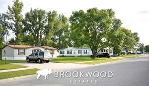 Residents at Brookwood Estates enjoy beautiful natural surroundings with plenty of greenery.