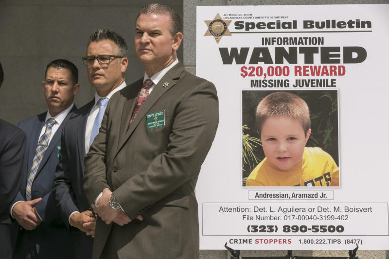 Los Angeles County Sheriff's Department Homicide Bureau Capt. Christopher Bergner, center, stands by a poster of Aramazd Andressian Jr., a 5-year-old boy who has been missing for several weeks from South Pasadena, Calif., at a news conference outside the Hall of Justice in Los Angeles Wednesday, May. 17, 2017, as Los Angeles sheriff's officials make a public plea for information about his whereabouts. Aramazd Andressian Jr., was last seen leaving Disneyland with his father on April 20. (AP Photo/Damian Dovarganes)
