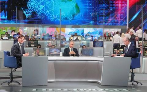 <span>Vladimir Putin takes questions during the show, many of which were recorded on the scene by state television crews </span> <span>Credit: Mikhail Klimentyev/TASS via Getty Images </span>