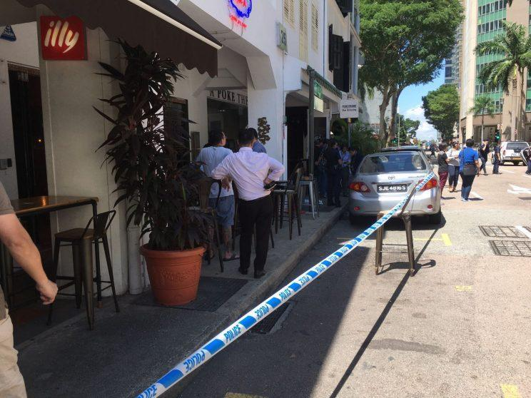 Police respond to an incident at Boon Tat street on Monday (10 July). (Photo: Gabriel Choo/ Yahoo Singapore)