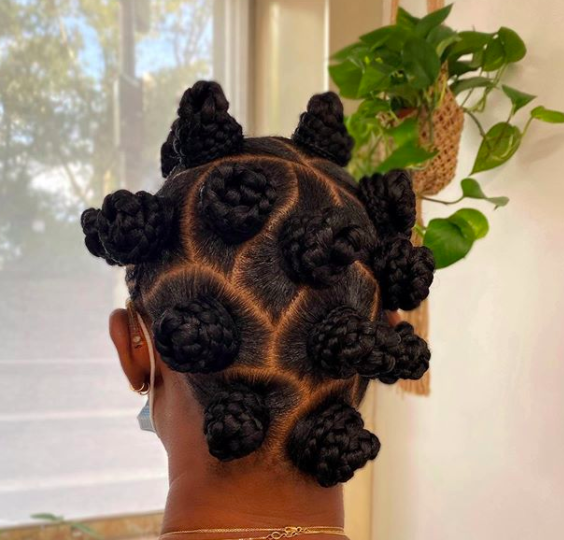 These bantu knots are the perfect mix of playful and chic, thanks to the curved parts and chunky, braided knots. This is a prime example of how switching up your parting can instantly refresh a tried-and-true classic.