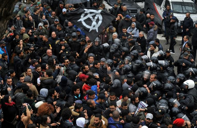Protesters confront security forces in the Tunisian capital during a demonstration over price hikes and austerity measures on January 12, 2018