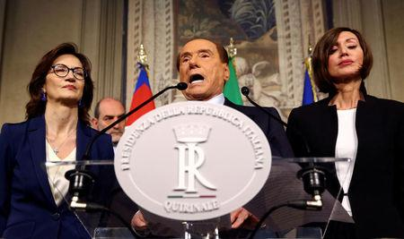 Forza Italia party leader Silvio Berlusconi speaks to the media during the second day of consultations with the Italian President Sergio Mattarella at the Quirinal Palace in Rome, Italy, April 5, 2018.  REUTERS/Alessandro Bianchi
